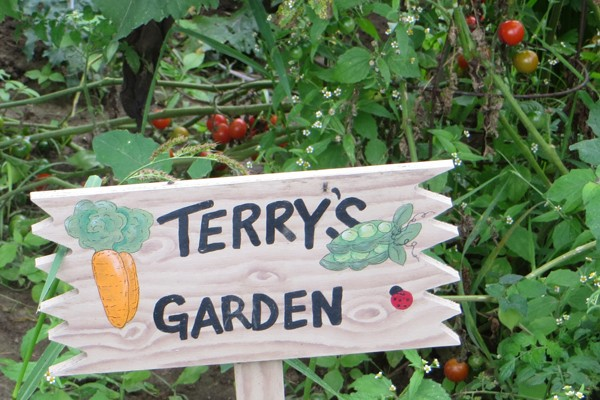 wooden sign for Terry's Garden
